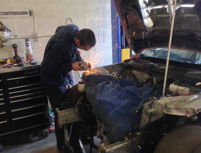 Liam sectioning out the chassis to give more clearance to the front upper control arms, which have been known to kiss the chassis at TMP and Mosport