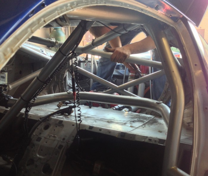Fizzer working hard removing the bulk-head and cutting out un-necessary sheet metal from inside the chassis. This will later be re-covered with the old aluminum paneling, and an aluminum enclosure will be built around the dry-break fuel fill area.